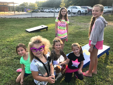 "ROCK STAR STUDENTS attended the recent family movie night hosted by the Michigan Avenue School PTO outside the school. The night's movie selection was ""SING,"" and students were encouraged to dress like rock stars."