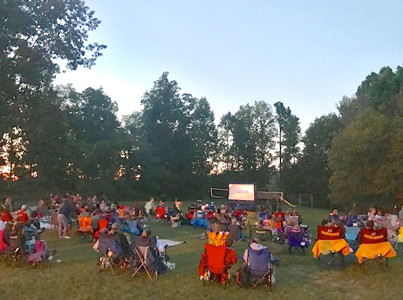 "THE MICHIGAN AVENUE SCHOOL PTO sponsored their annual free family movie night, where several hundred people joined to watch ""SING"" on the school's outdoor playground. Students dressed as their favorite rock stars, and a drawing was held for Scholastic Book Fair credits."