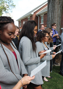 DIRKSEN ROW RESIDENTS recite the litany of dedication during Friday's festivities.