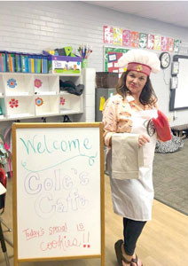 JENNY COLE, a third-grade teacher at Taylor Elementary School, waits to treat students to some tasty math problems after transforming her classroom into a math cafe. Students used the day's special — cookies — to practice math.