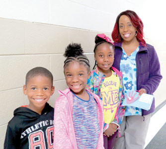 STUDENTS La'Terries Hollins, Calia Russell, and Jiyana Hollins attended Goodies for Grandparents at Black Fox Elementary School with their guest, Kila Russell.  More than 300 family members joined the students at school.