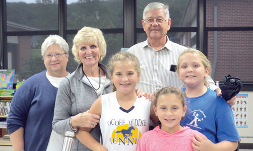 ASHLYN STUMAN AND MYLEE GOODWIN welcomed Addison Stuman, Kay Stuman, and Marsha and Bill North to Black Fox Elementary School for Goodies for Grandparents.  Among the activities families enjoyed was getting to dedicate books in the school library.