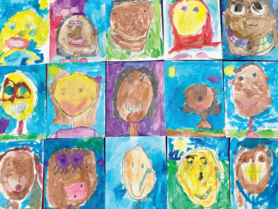 YOUNG CREATIVES in Teah Shope's class at Waterville Community Elementary School spent two weeks learning to write autobiographies. Students then created self-portraits by looking in a mirror and using crayons and watercolors to draw themselves. The result was a diverse patchwork of color.