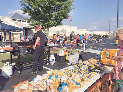 HUNDREDS OF RESIDENTS flocked to last year's National Night Out, where they learned about law enforcement and other emergency response teams, had games for kids, and were served hot dogs and other food by members of the Cleveland Police Department and Bradley County Sheriff's Office.