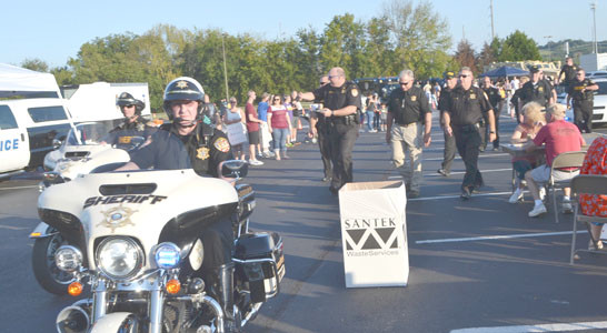 A MOTORCYCLE ESCORT brought the confident Bradley County Sheriff's Office doughnut eating team, and the trophy won last year, to the staging area at Tuesday night's competition.