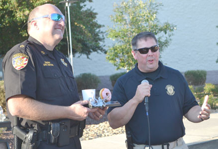 BEFORE the doughnut eating contest at Tuesday's National Night Out, Bradley County Sheriff Eric Watson, left, and Cleveland Police Chief Mark Gibson thanked those attending.