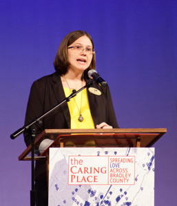SPEAKER CORINNE FREEMAN summarizes The Caring Place's new vision and program, Getting Ahead, which focuses on helping clients not only to meet basic needs, but to envision and attain lasting change in their lives.