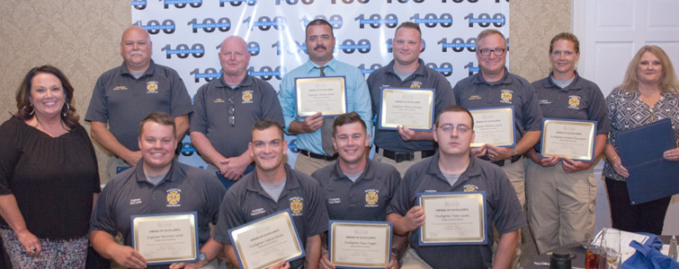 Zandra Welch, left, and Janey Patten, right, present awards to BCFR members Randy Watson, Troy Maney, Daniel James, Marcus Burger, William Lamb, Loretta Thompson. Lower row: Nicholas Lamb, Ryan Hager and Tyler Jones.