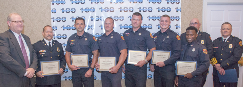 Kelvin Bishop, left, presents awards to CFD members Robert Gaylor, T.J. Smith, Michael McCabe, Jake Hill, Zach Jaggers, and Sammy Previlus. Standing with them are Chaplain Gary Sears and CFD Chief Ron Harrison.