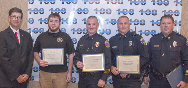 Stephen Crass, left, and Cleveland Police Chief Mark Gibson, right, present awards to 911 Communications Sean Williams, Lt. Brian Pritchard and Officer Chris Mason.