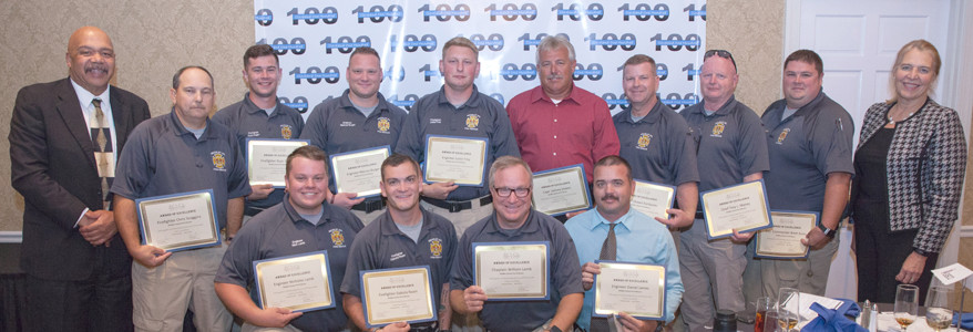 Drew Robinson, right, and Judge Sandra Donaghy, right, give awards to members of the Bradley County Fire-Rescue. At top: Chris Scoggins, Ryan Hager, Marcus Burger, Justin Frey, Johnny Stokes, Shawn Fairbanks, Troy Maney and Brett Dunn; Lower row: Nicholas Lamb, Dakota Ream, William Lamb and Daniel James.