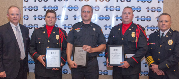 Jeff Underwood, left, and CFD Chief Ron Harrison, right, present awards to Engineer Kevin Hair, Lt. Jason Parks and Engineer Kevin Nunnelly.