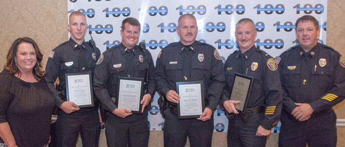 Zandra Welch, left, and CPD Chief Mark Gibson, right, present awards to Officers Michael Gunnell, Taylor Thompson, Tracy Maxfield and Lt. Brian Pritchard.