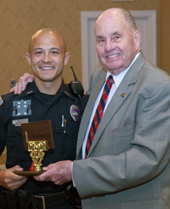 Mayor Tom Rowland, right, gives special recognition to Cleveland Police Officer Sean Bulow, who won people's hearts by dancing in support of The Salvation Army.