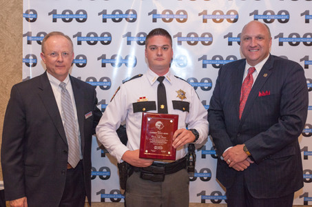 Jeff Underwood, left, and Sheriff Eric Watson, right, present an award to BCSO Deputy Jeff Wagner.