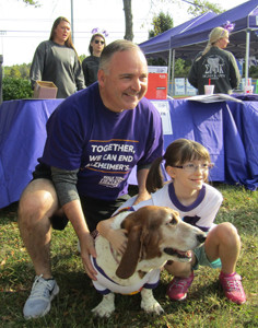 State Rep. Kevin Brooks stops to pose with Dakota Faricelli, 8, and Trixie the Memory Hound at Saturday's Walk to End Alzheimer's.
