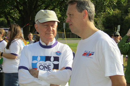 Life Care Centers  Of America President Beecher Hunter pauses for a conversation with 10th District Attorney General Steve Crump as they prepare for the Walk to End Alzheimer's at the Greenway.