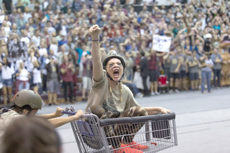 Students compete in the crowd-favorite shopping cart race.