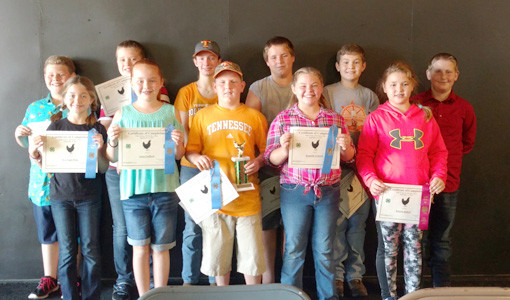 Some of the poultry participants with their awards. From left, front, are Kayleigh Price, Anna Ledford, Deagan Price, Kennedy Goforth, and Kenzlie Ballew; back,  Jed Pritchett, Chase Hyatt, Rose Collins, Derek Burgess, Landon Allen, and Anthony Bledsoe.