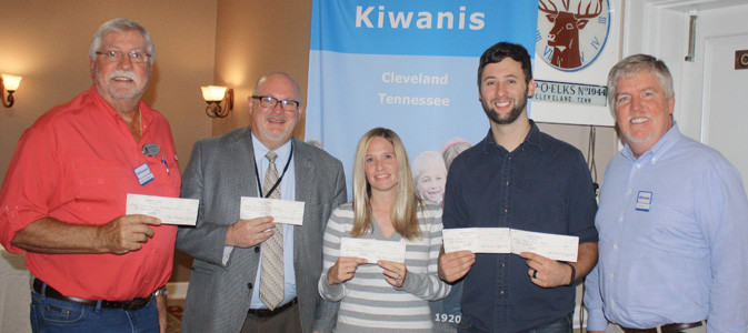 FOUR PEOPLE RECEIVED five checks in special presentations by the Cleveland Kiwanis Club Thursday. Outgoing Club President Jeff Miller, right, presented the monetary awards to, from left, Dennis Botts of Life Education Through Sports, Andy Hunt of the Cleveland/Bradley County Public Library, Kelli Kyle of  The Refuge and Mike Stoess of the Boys and Girls Clubs of the Ocoee Region. Stoess is also the new Kiwanis president.