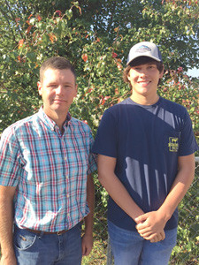 CSCC agriculture instructor Mitch Ingram  poses with agribusiness student Brandon Conley.