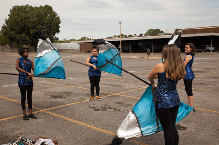 SALE CREEK STUDENTS, right, practice with their flags before their performance at the Bradley Classic.