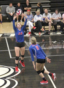 CLEVELAND'S Anna Renshaw (36) set the ball as Nicole Glaser moves in during the District 5-3A volleyball semifinals Monday, at Bradley Central.
