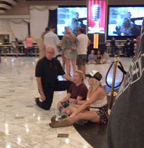 SEVERAL ATTENDING Sunday night's outdoor concert in Las Vegas were able to run to the MGM Hotel for protection. Former Clevelander and Banner photographer Angela McClure Mathis was at the MGM and took this photo of emotional patrons in the area.