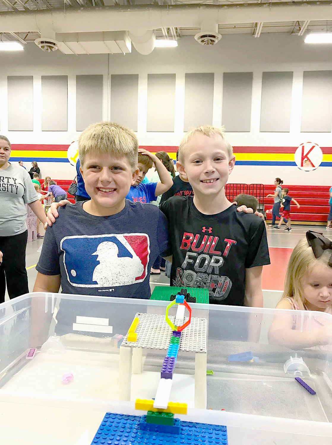 SECOND-GRADERS Braxton Reagen, left, and Tyler Neely used Legos to build a bridge across water during STEAM Family Night at  Waterville Community Elementary.