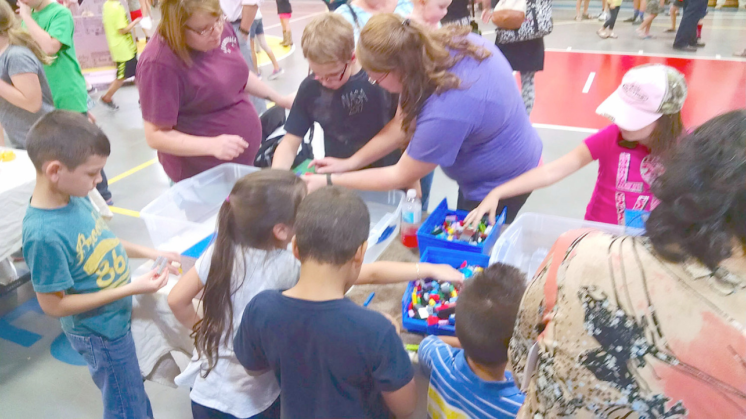 BUILDING BRIDGES, students experiment with architecture during an event at Waterville Community Elementary. The school's PTO recently sponsored a STEAM Family Night put on by the Creative Discovery Museum.