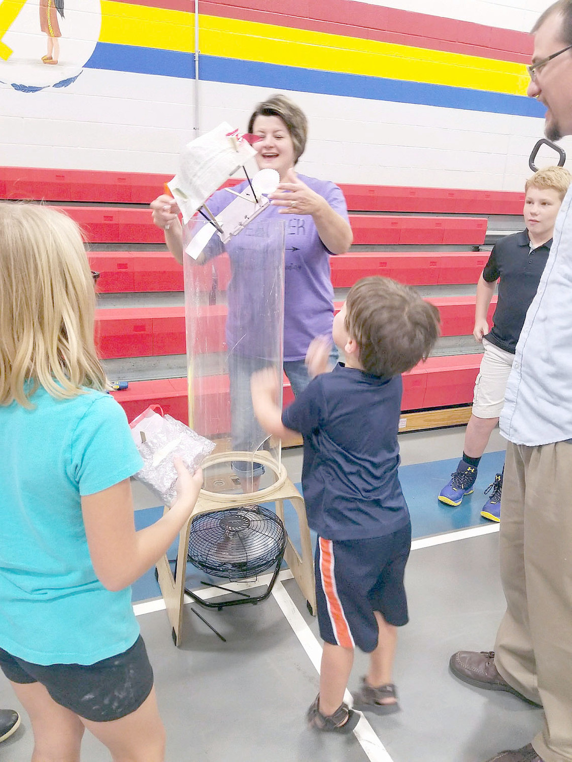 STUDENTS used common household items, such as cupcake liners, popsicle sticks, and glue, to see if they could create something that would fly, during STEAM Family Night at Waterville Community Elementary.