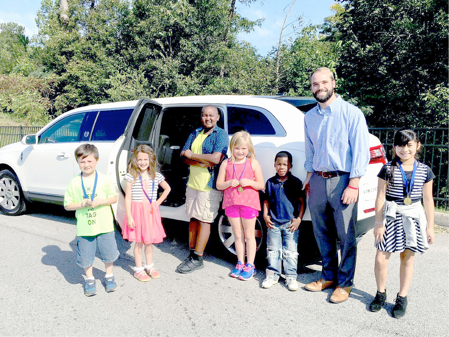 MAYFIELD ELEMENTARY students, along with the school's BEST Partner, Companion Funeral Home, took a limo ride to Jenkin's Deli for lunch.  These students were chosen because of upstanding citizenship and great character. Pictured, from left, are Pictured:  Bryce Cowan, Grace Ramos, T.J. Lisulo, Atti Crisp, Elijah Zachary, Daniel Pierce of Companion Funeral Home, and Carolina Ron Silva.