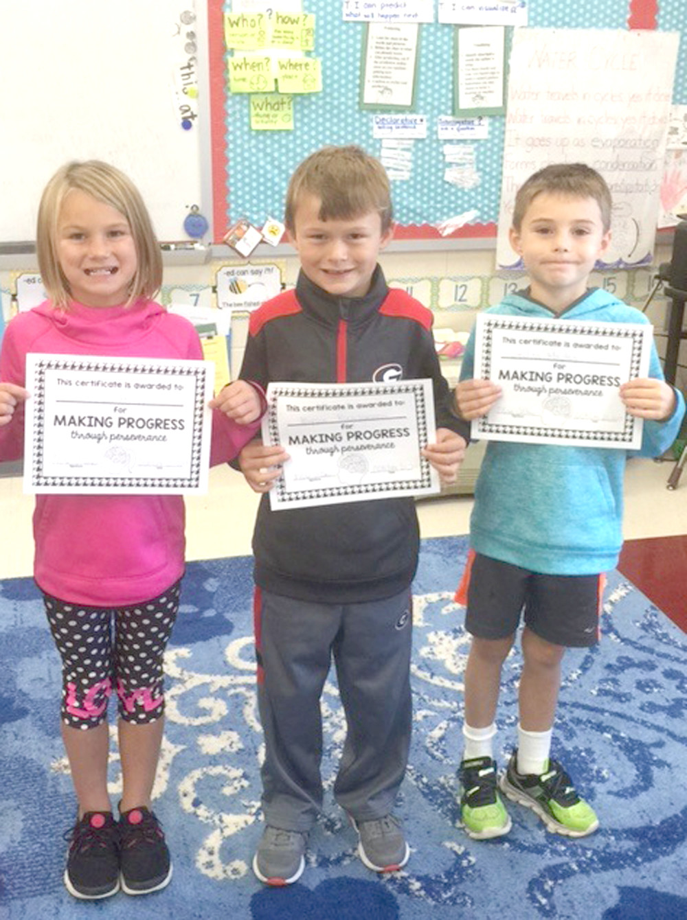 "FIRST-GRADERS in Karen Allen's class at Park View Elementary were honored for making the ""A"" honor roll and making progress through perseverance. From left are Allie Hagy, Bryson Kirschmann and Declan Maples."