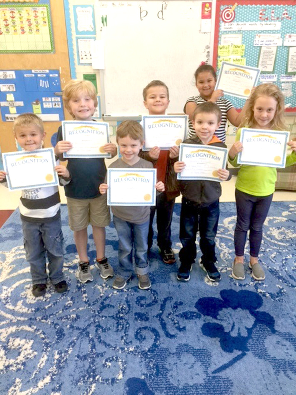 "STUDENTS in Karen Allen's first-grade class at Park View Elementary were honored by their teacher for outstanding achievement after making the ""A"" honor roll. In the first row, from left, are Trenton Long, Micah Brown, Bradley Raasveld and Casi Dicus. In the second row are Ethan Brafford, Christian Bryant and Gigi Robles."