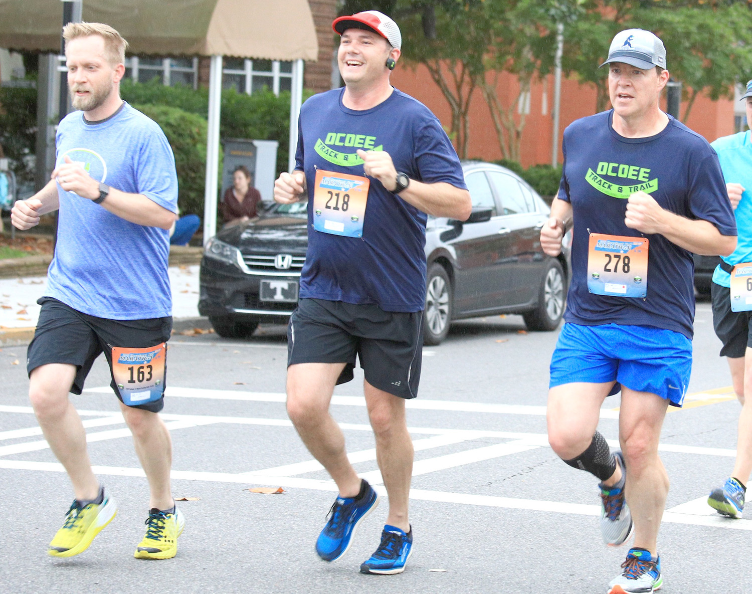 RUNNING WITH FRIENDS is something that Matt Ryerson, right, enjoys. He has run for over 1,050 straight days, many of them with fellow runners Jeff Salyer, left, and Yuri Davis, center.