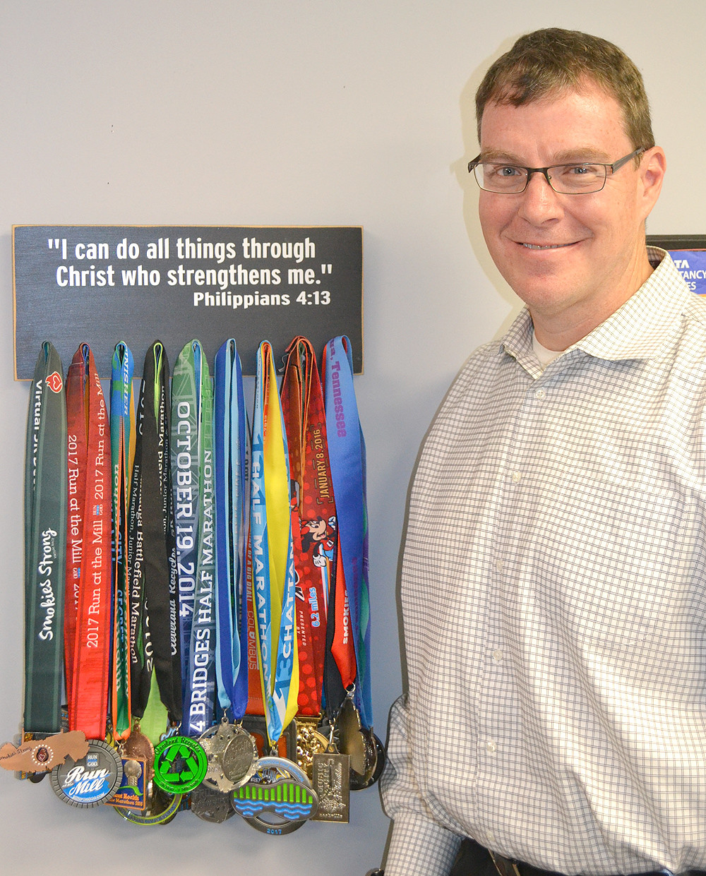 MATT RYERSON, president and CEO of United Way of the Ocoee Region, is also a dedicated runner, earning medals from around 35 races in which he has participated.