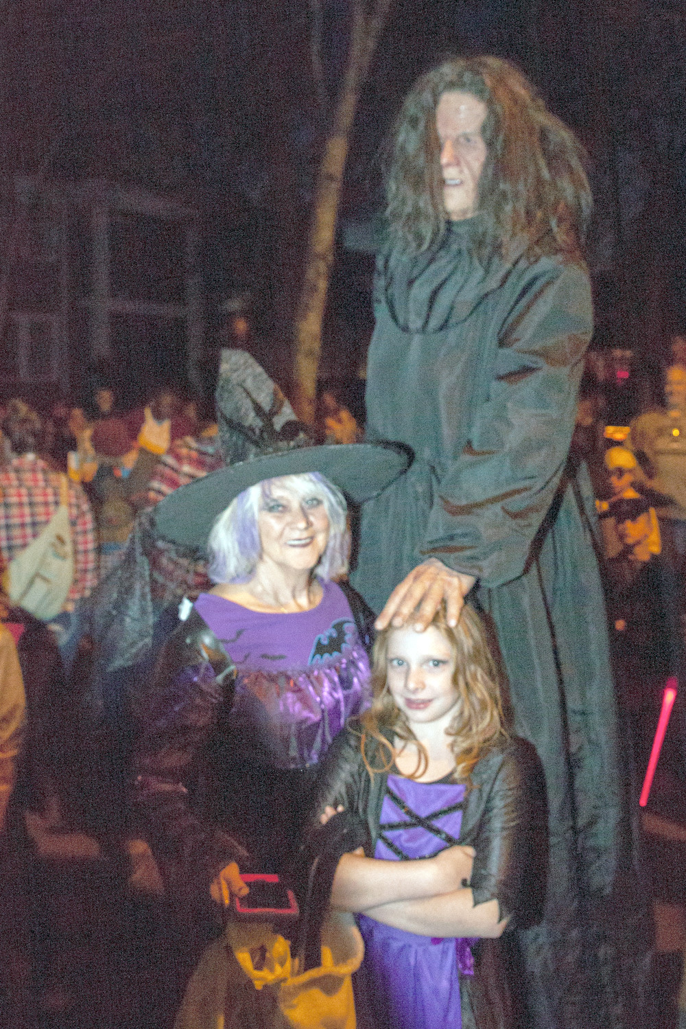 JUST AS PREDICTED, Tall Betsy made an appearance on Centenary Avenue on Halloween night.  She was surrounded by throngs of people requesting photographs with the local legend.  With Tall Betsy are Donna Adams, left, and Kyliegh Adams