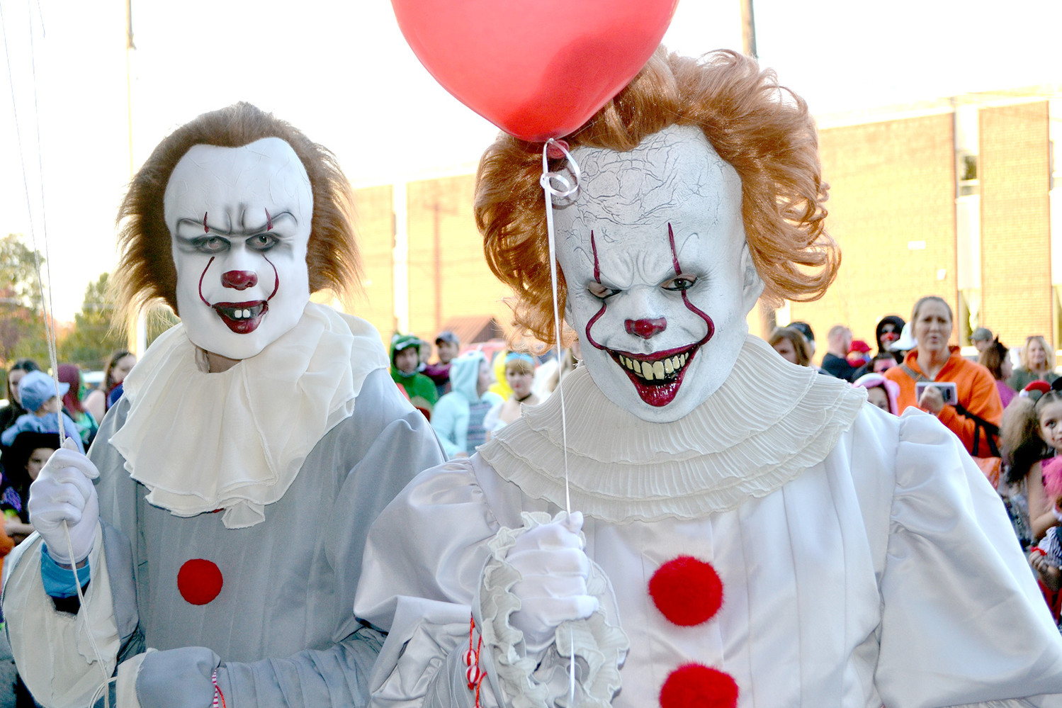 "THE COURTHOUSE SQUARE was filled with clowns from the movie ""It."" Though scary looking given their context, the clowns also fit into the friendly atmosphere of the Block Party."