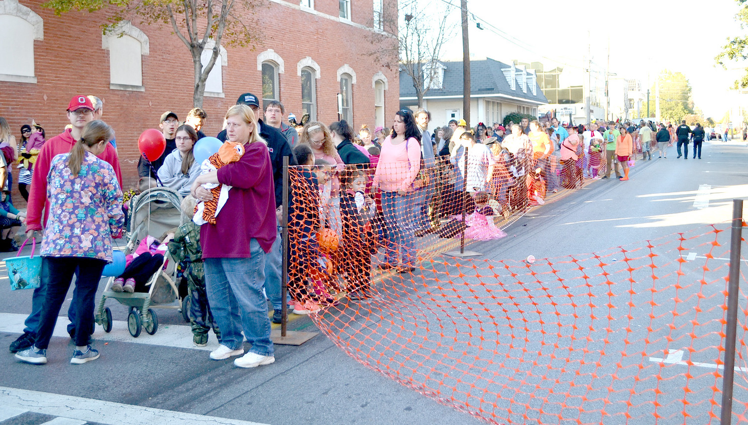 "SEVERAL STREETS DOWNTOWN were filled with children and their parents, getting candy at ""Treat Street."" sponsored by M&M Mars."