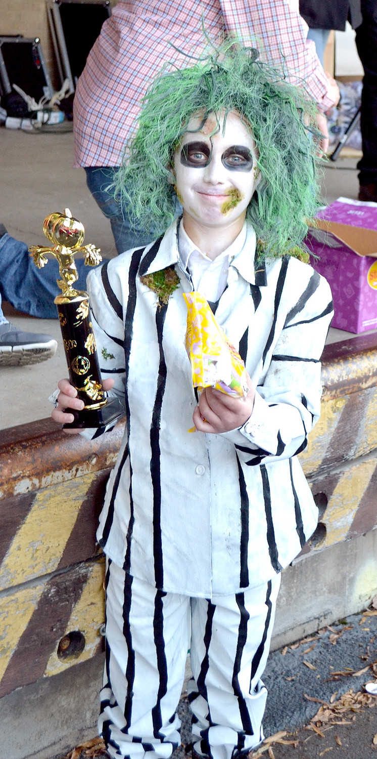 THERE WERE MANY movie characters in costume at the Halloween Block Party, including Beetlejuice, a costume contest winner.