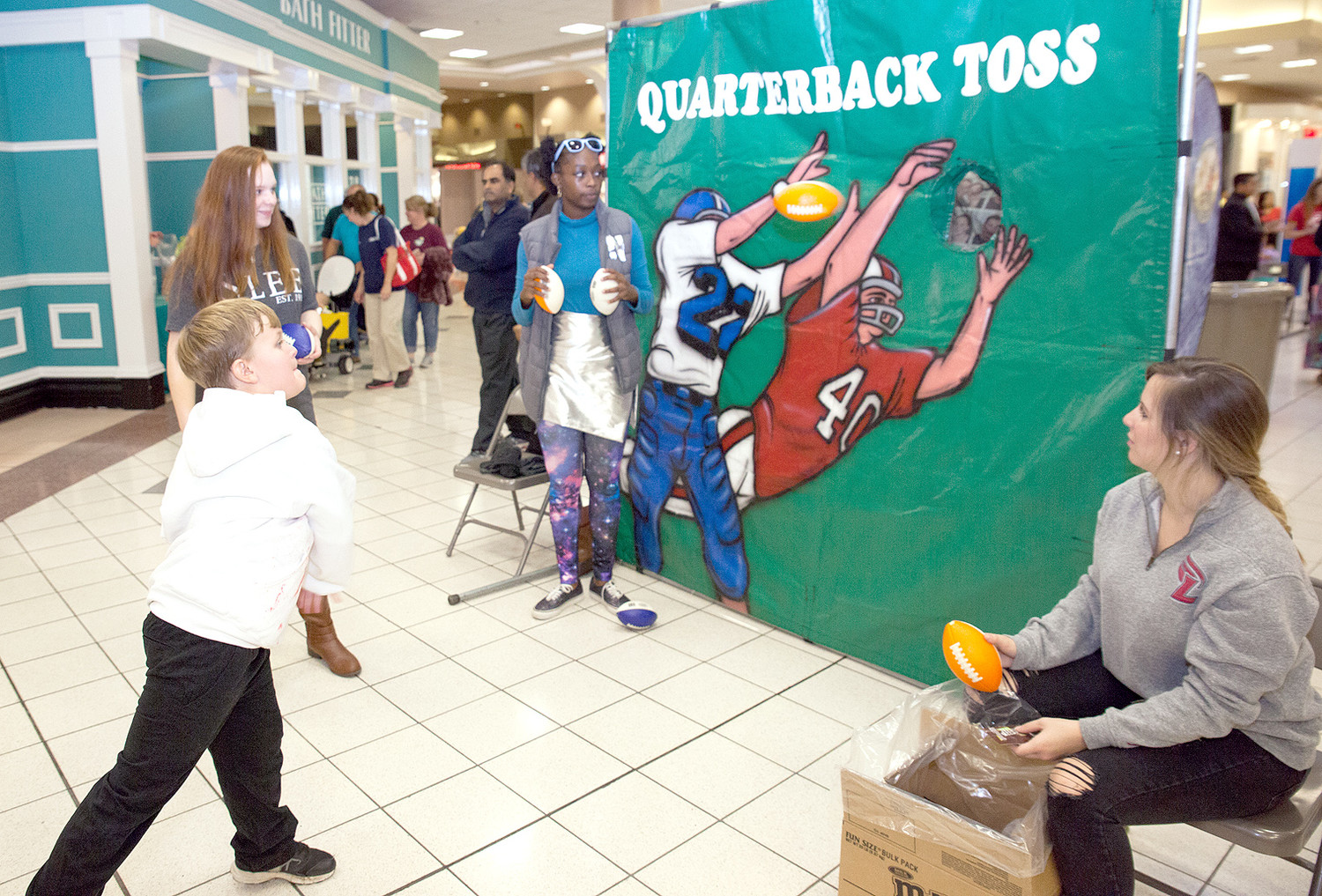 Brayden Milam completes a pass at the Quarterback Toss during the annual Spooktacular Fall Festival at Bradley Square Mall.  The event is sponsored by Westwood Baptist Church, River Hills Church of God and Westmore Church of God.