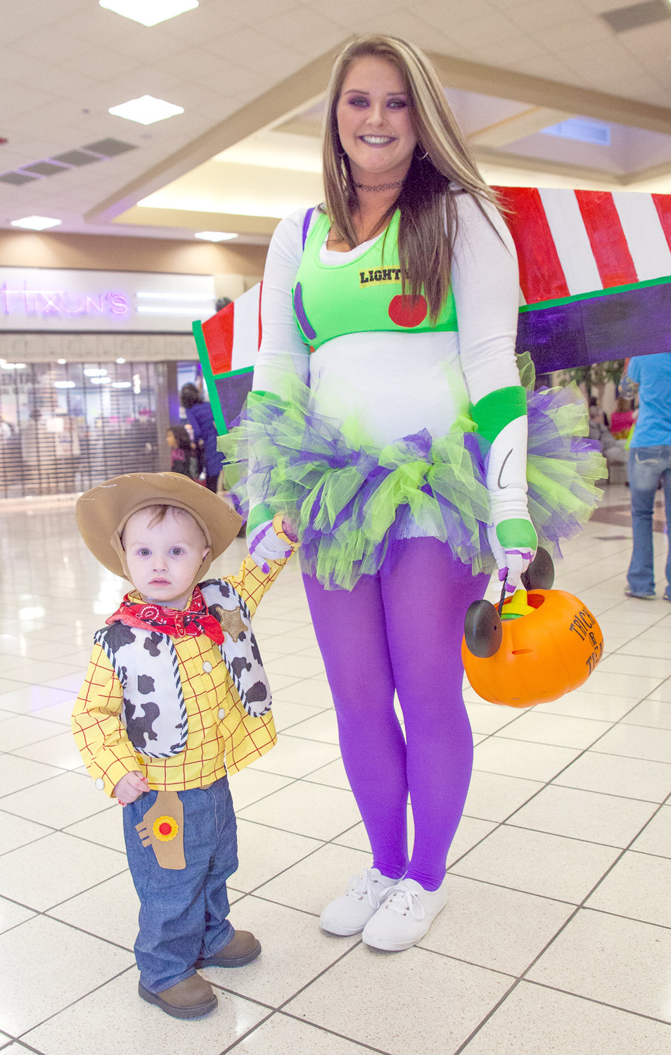 "WOODY AND BUZZ LIGHTYEAR were in attendance at the Spooktacular mall event on Tuesday night. From left are Kayson Jenkins, dressed as Woody, and Kelsey Jenkins, dressed as Buzz Lightyear, both from ""Toy Story."""