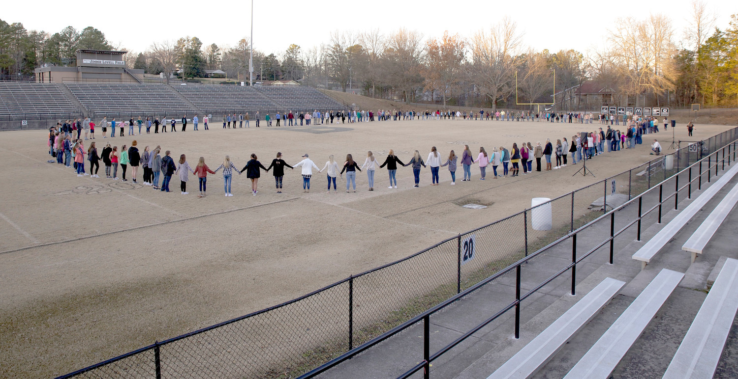 THE PRAYER CIRCLE that formed during the closing of Sunday night's Prayer Revival at Bradley Central High School stretched almost entirely around the BCHS football field.