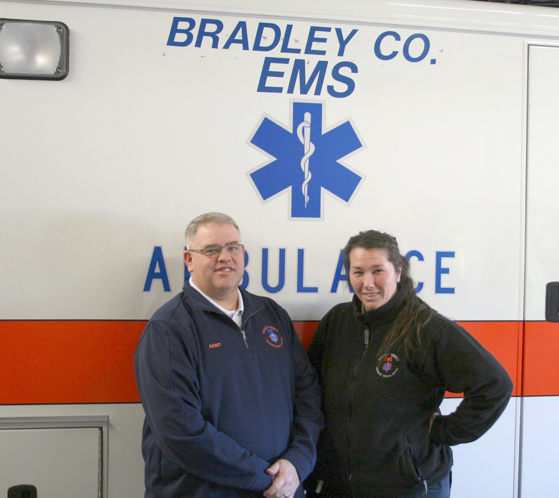 TWO BRADLEY COUNTY EMS workers stand next to an ambulance at their facility located off Paul Huff Parkway. From left are EMT Nicky Norwood and paramedic Katie Summers.