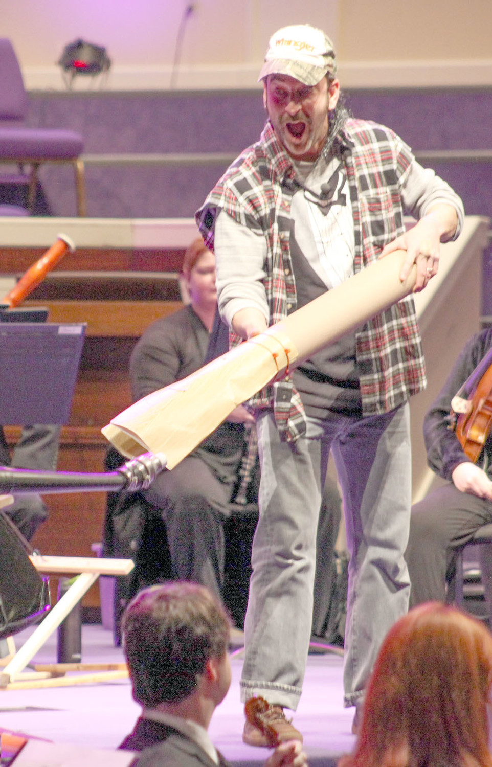 USING A HOMEMADE visual aid made from pieces of wood and a leaf blower, Narrator Tator (pictured at left), demonstrates the vibrations of the double reed oboe.