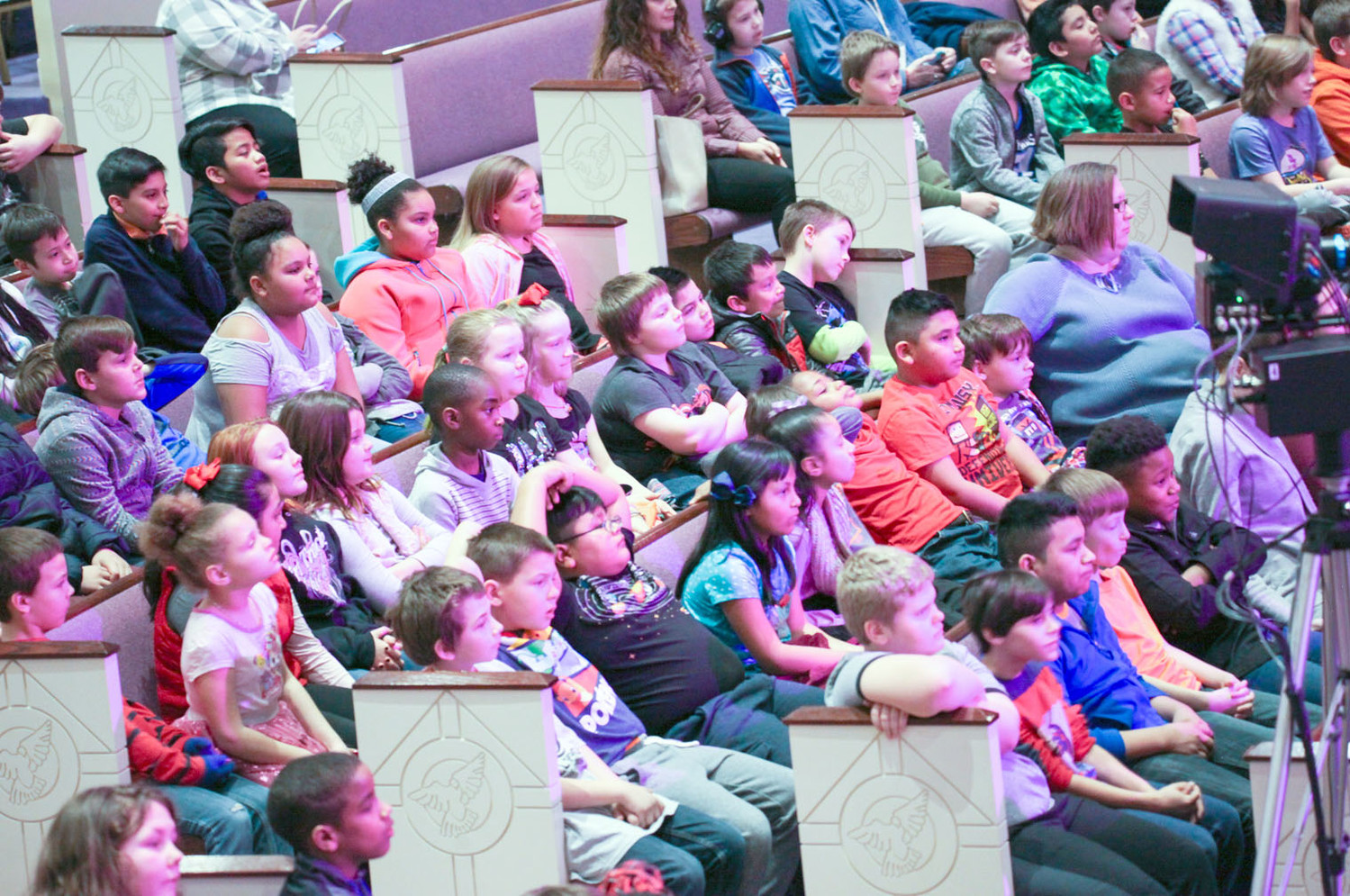 CLEVELAND CITY STUDENTS watch and listen to the different families of instruments being discussed during the Chattanooga Symphony's interactive, instructional concert on Friday afternoon.