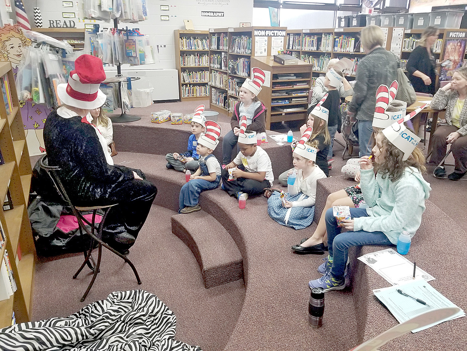 "Erica Fowler, a CSCC student dressed as ""the Cat,"" reads ""The Cat in the Hat"" to students."
