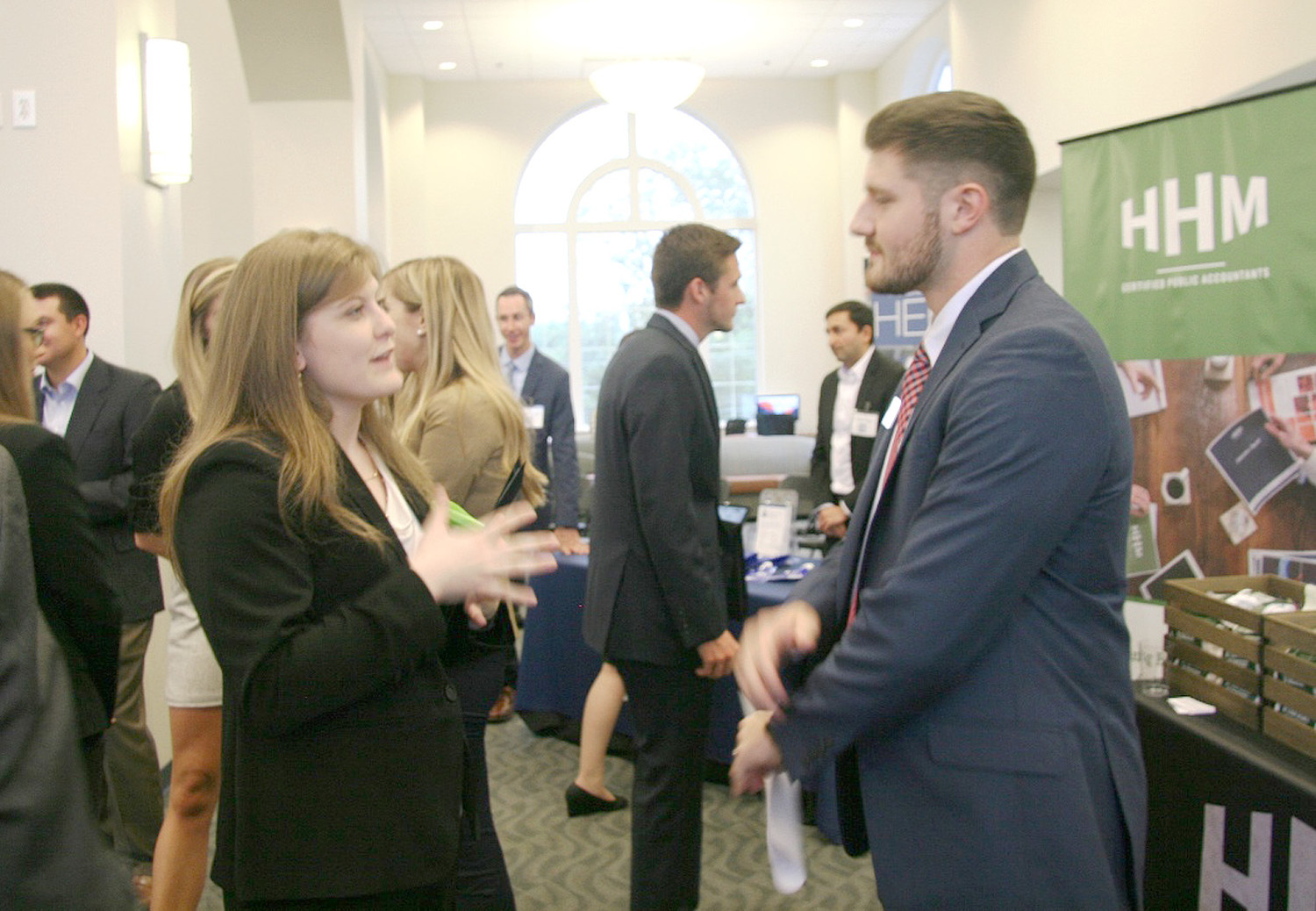 Lee student Emily Holden, left, speaks with Lee alumnus Kyle Briner from the firm Henderson, Hutcherson & McCullough.