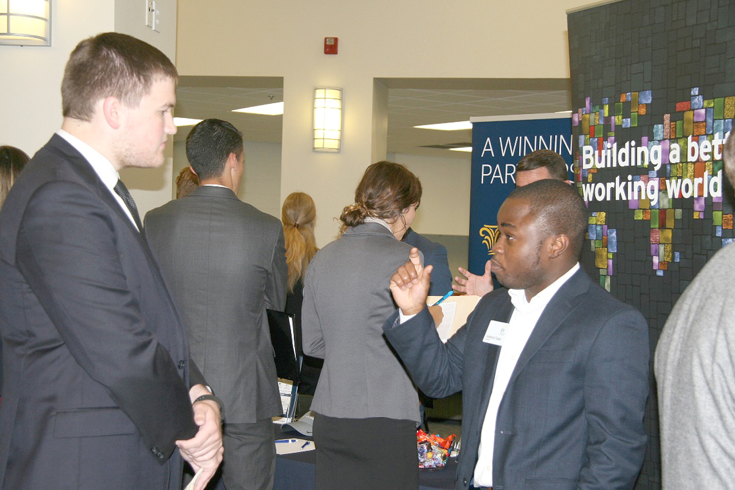 "Lee student Timothy Powers, left, meets with a representative from Ernst & Young during the ""Meet the Firms,"" held at the university."