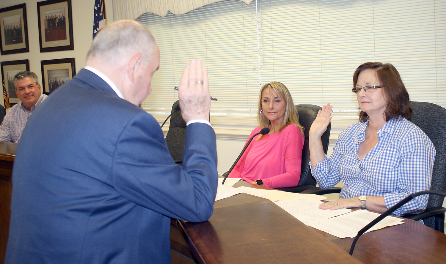 PAT OWNBY, right, a new member of the city's Animal Control Board, is administered her oath of office Thursday by Cleveland Mayor Tom Rowland. Other board members are Tom Cassada, left, and Rachel Veazey.
